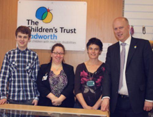 Chris Grayling is shown around the new Tadworth Children's Shop in Epsom – June 2012